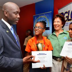Mr. Minto, Ms. Abrahams and 1st place winners from Denham Town Primary School a tie for 1st Head Boy & Girl