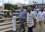 Chairman of the Tourism Enhancement Fund (TEF), Godfrey Dyer (front right), observes as Mayor of Montego Bay, Councillor Homer Davis (front left), gestures. Two were on a tour of sections of Montego Bay to observe the progress of the Sidewalk Rehabilitation Programme on Monday, August 21, 2017. Superintendent of Roads and Works (Acting) Saad Campbell (right) and Deputy Mayor of Montego Bay, Councillor Leeroy Williams also participated in the tour.