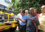 Local Goverment Minister and Community Development, Hon. Noel Arscott (Centre) delivers brand new fire engine to Clarendon. With him are (from left) Mayor of May Pen, Councillor Scean Barnswell (left); Member of Parliament for Central Clarendon, Mr. Mike Henry and Assistant Commissioner of the Jamaica Fire Brigade, John Forester.