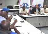 Mayor of Montego Bay, Councillor Homer Davis (centre), makes a point to media personnel at a press brief on the status of the Bogue Lands. Saring the moment are Deputy Mayor of Montego Bay, Councillor Leeroy Williams (left at head-table) and Chairman of the Finance Committee, Councillor Everes Coke.