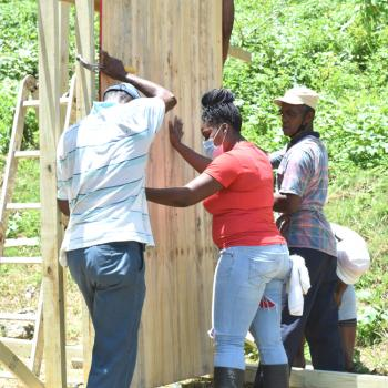 PR Officer Shadae Norman Assists Placement of Ply on Structure